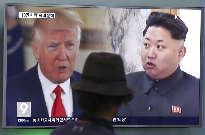 A man watches a television screen showing U.S. President Donald Trump and North Korean leader Kim Jong Un during a news program at the Seoul Train Station in Seoul, South Korea.(AP Photo/Ahn Young-joon, File)