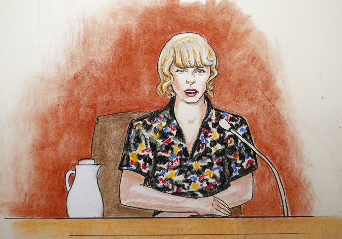 In this courtroom sketch, pop singer Taylor Swift speaks from  the witness stand during the trial in Denver. (Jeff Kandyba via AP)