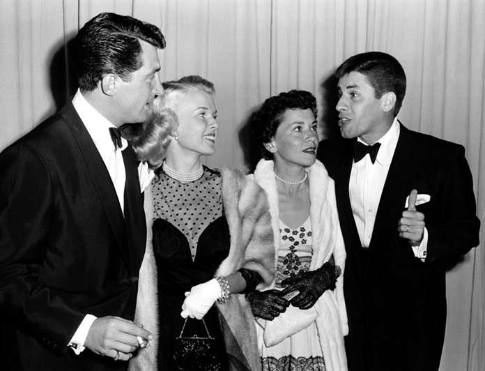 In a March 29, 1951 file photo, actor-comedian Dean Martin, left, and his wife, Jeanne, are shown with actor-comedian Jerry Lewis, far right, and his wife, singer Patti, as they arrive at the Academy Awards presentations at the RKO Pantages Theatre in Los Angeles.(AP Photo, File)