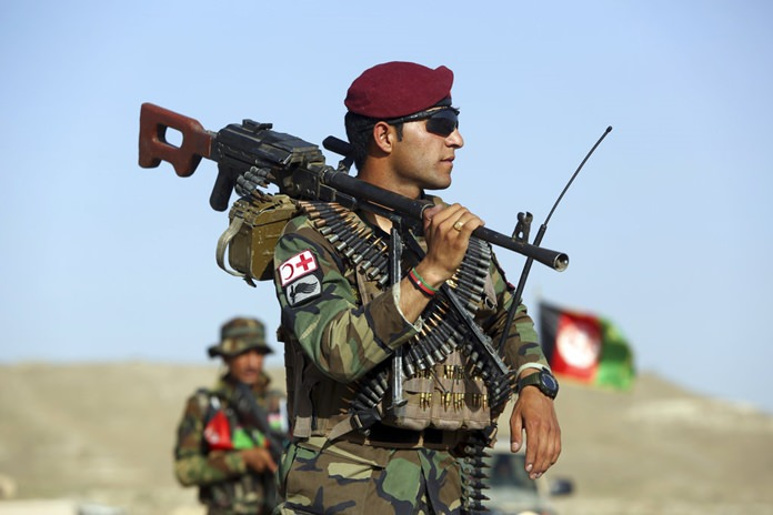 Afghan National Army soldiers stand guard at a checkpoint on the outskirts of Kabul, Afghanistan, Monday, Aug. 21, 2017. (AP Photo/Rahmat Gul)