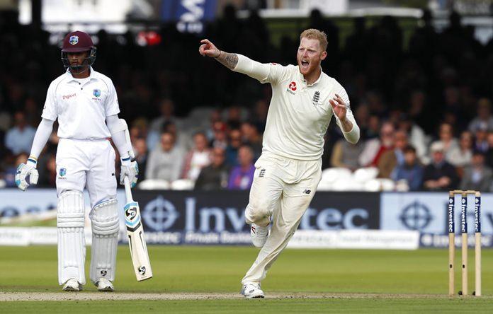 England's Ben Stokes celebrates taking the wicket of West Indies' Roston Chase.(AP Photo/Kirsty Wigglesworth)