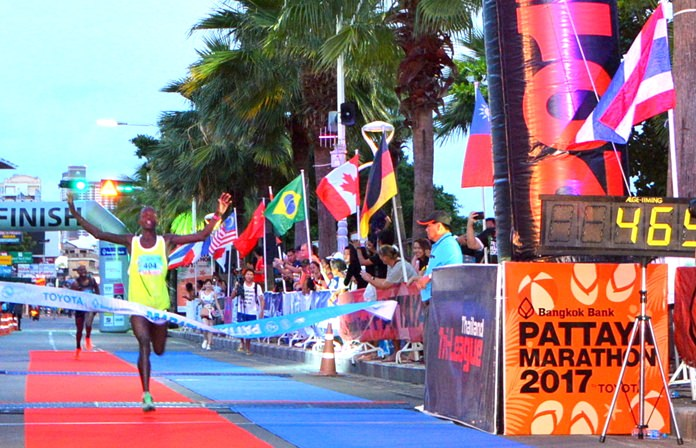 Gilbert Muge, of Kenya, races to cross the finish-line on his way to winning the Pattaya Marathon 2017.