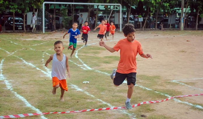 Young athletes sprint for the finish line.