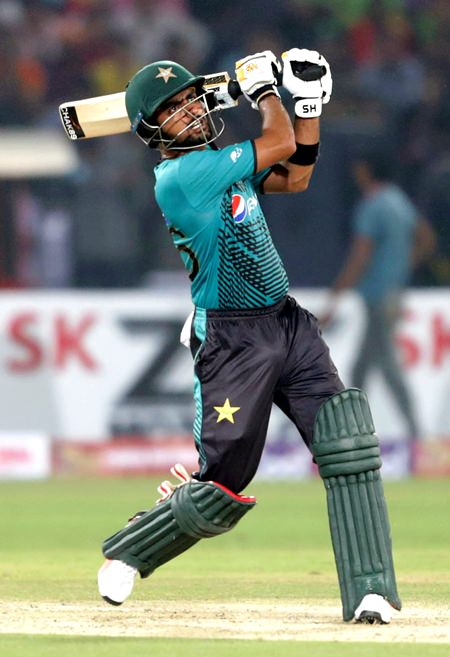 Pakistani batsman Babar Azam hits a boundary against the World XI during the first Twenty20 match at the Gaddafi Cricket Stadium in Lahore, Pakistan, Tuesday, Sept. 12. (AP Photo/K.M. Chaudary)