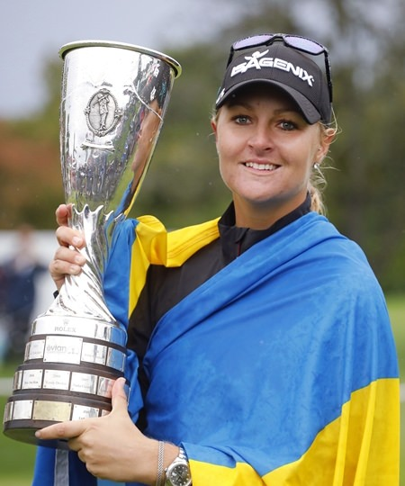 Anna Nordqvist of Sweden celebrates with her trophy after winning the Evian Championship women's golf tournament in Evian, eastern France, Sunday, Sept. 17. (AP Photo/Laurent Cipriani)