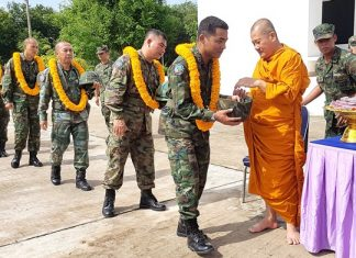 Military personnel receive a Buddhist amulet to give them courage and keep them safe in the Far South.