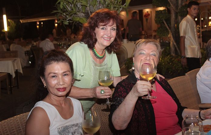 (From left) Nittaya Patimasongkroh, Gina Herning drink a toast to Elfi's health.