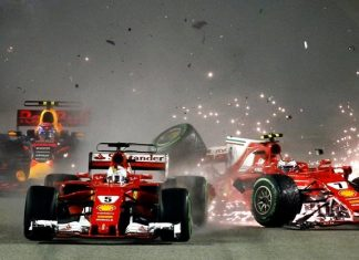 Ferrari driver Kimi Raikkonen (right) of Finland collides with teammate Sebastian Vettel of Germany at the start of the Singapore Formula One Grand Prix on the Marina Bay City Circuit Singapore, Sunday, Sept. 17. Vettel's title rival, Lewis Hamilton of the Mercedes team, won the race to extend his championship lead.