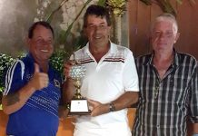 Trevor Oliver (centre) accepts the King of the Mountain trophy from Derek Thorogood (left) and Jim Cooper.