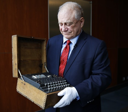H. Keith Melton holds an Enigma Machine used in World War II to encode messages. (AP Photo/Jacquelyn Martin)
