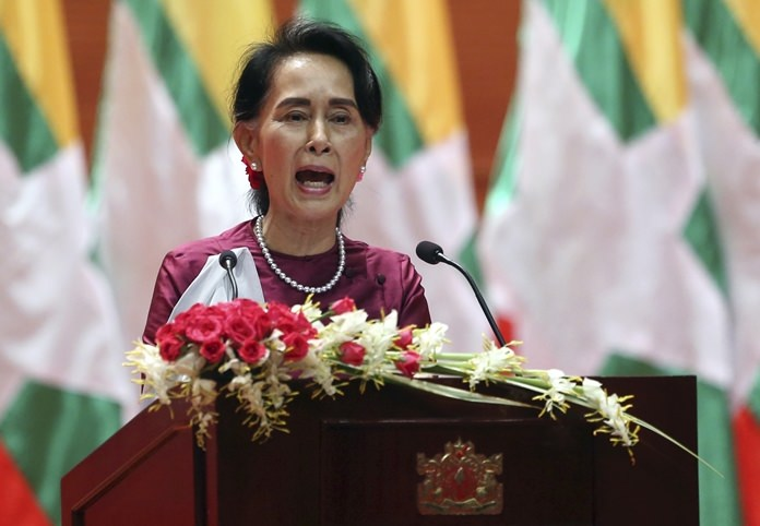 In this Tuesday, Sept. 19, 2017 file photo, Myanmar's State Counselor Aung San Suu Kyi delivers a televised speech to the nation at the Myanmar International Convention Center in Naypyitaw, Myanmar. After a mass exodus of Rohingya Muslims sparked allegations of ethnic cleansing, Myanmar leader Aung San Suu Kyi said Tuesday her country does not fear international scrutiny. (AP Photo/File)