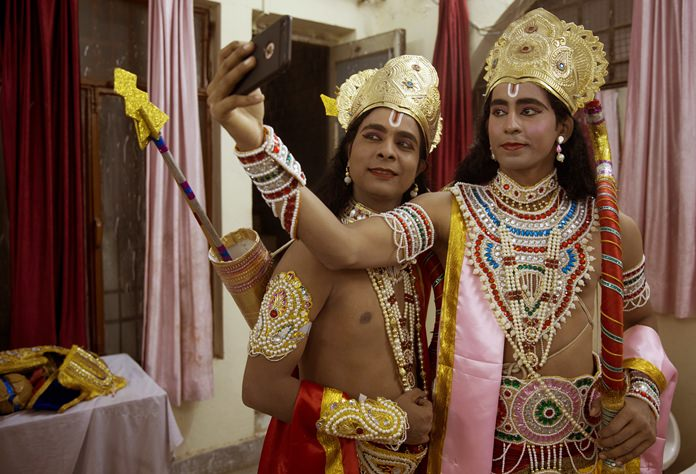 In this Thursday, Sept. 21, 2017 file photo, Indian artists dressed as Hindu god Rama, right, and his brother Lakshman take a selfie before performing a traditional Ramleela drama, narrating the life of Hindu God Rama, during Dussehra festivities in Allahabad, India. The Hindu festival of Dussehra commemorates the triumph of Lord Rama over the demon king Ravana, marking the victory of good over evil. (AP Photo/Rajesh Kumar Singh, File)