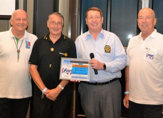 MC Roy Albiston poses with Rotary Club Eastern Seaboard members (l to r) Jan Abbink, Carl Dyson, and Brian Songhurst, after presenting them with the PCEC's Certificate of Appreciation.