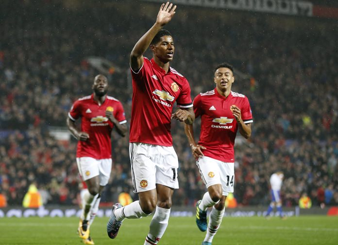 Manchester United's Marcus Rashford, center, celebrates his goal during the Champions League group A match against Basel, at Old Trafford stadium in Manchester, Tuesday, Sept. 12. (AP Photo/Frank Augstein)