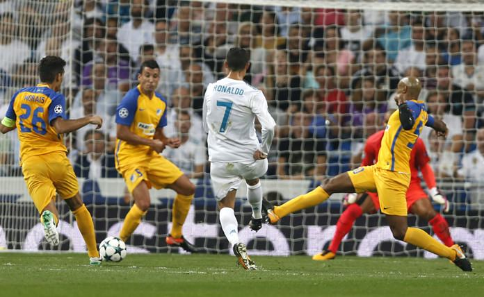Real Madrid's Cristiano Ronaldo (7) fires in a shot against APOEL Nicosia during their Champions League group H match at the Santiago Bernabeu stadium in Madrid, Spain, Wednesday, Sept. 13. (AP Photo/Francisco Seco)