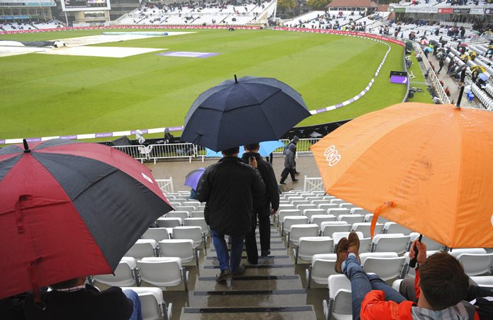 Spectators wait as rain stops play during the second One Day International match between England and West Indies at Trent Bridge, Nottingham, England, Thursday, Sept. 21, 2017. (AP Photo/Rui Vieira)