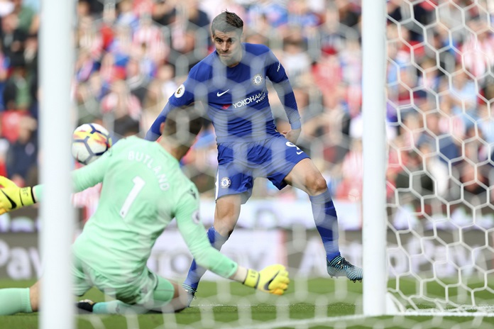 Chelsea's Alvaro Morata scores his side's third goal of the game during the English Premier League match against Stoke City at the bet365 Britannia Stadium in Stoke-on-Trent, Saturday, Sept. 23. (Nigel French/PA via AP)