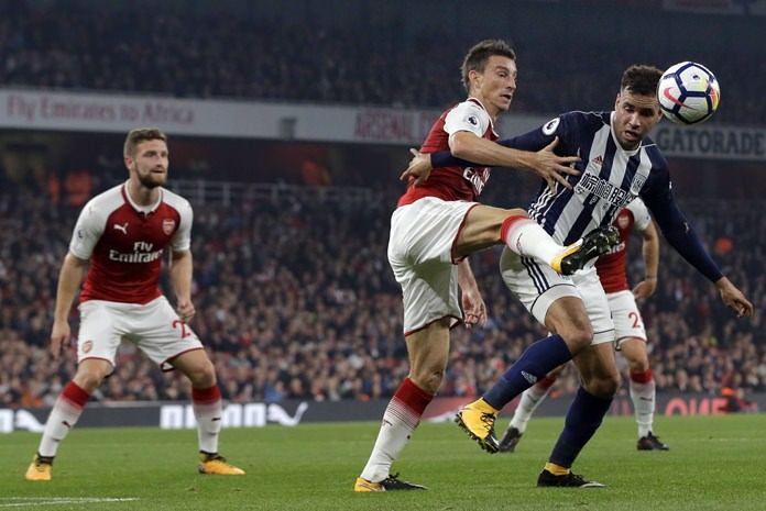 West Bromwich Albion's Hal Robson-Kanu, right, vies for the ball with Arsenal's Laurent Koscielny during their teams' English Premier League match at the Emirates stadium in London, Monday, Sept. 25. (AP Photo/Alastair Grant)