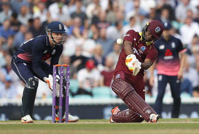 West Indies' Evin Lewis plays a shot off the bowling of England's Moeen Ali during the fourth One Day International at the Oval cricket ground in London, Wednesday, Sept. 27. (AP Photo/Kirsty Wigglesworth)