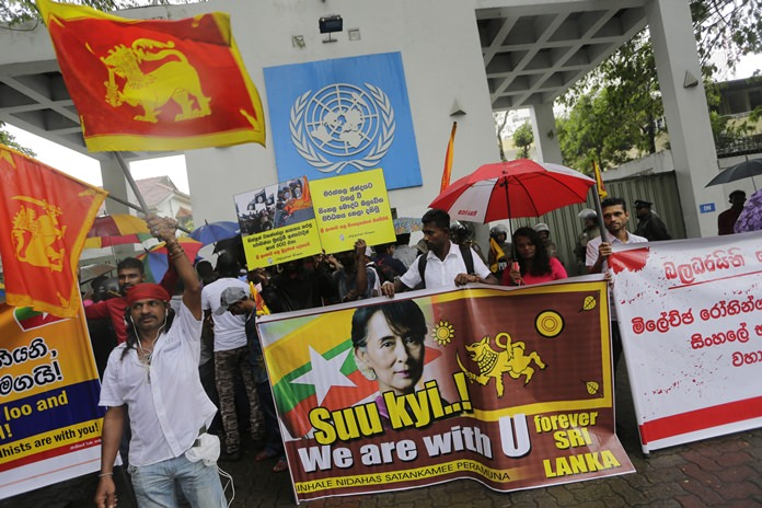 A group of Sri Lankan Buddhists protest outside the U.N. office in Colombo, Sri Lanka, Wednesday, Sept. 27. The protestors expressed their solidarity with Buddhists in Myanmar and opposed any move to bring Rohingya refugees to Sri Lanka. (AP Photo/Eranga Jayawardena)