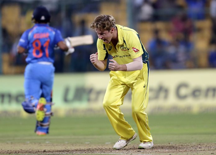 Australia cricketer Adam Zampa celebrates taking the wicket of Indian batsman Hardik Pandya during the fourth one-day international in Bangalore, India, Thursday, Sept. 28. (AP Photo/Rajanish Kakade)
