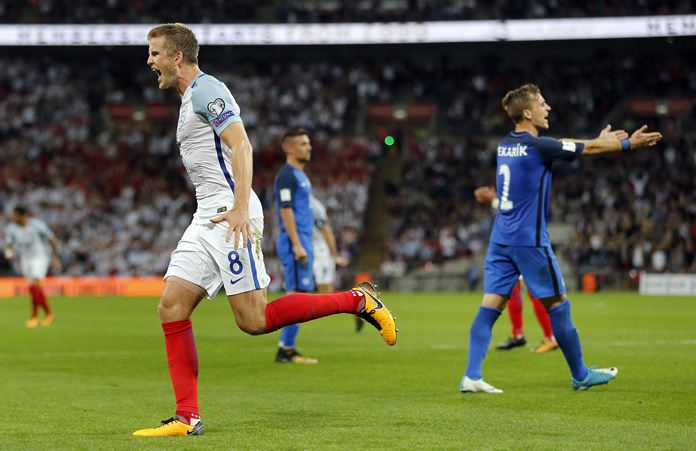 England's Eric Dier, left, celebrates after scoring his side's equalizing goal during the World Cup Group F qualifying match against Slovakia at Wembley stadium in London, Monday, Sept. 4. (AP Photo/Frank Augstein)