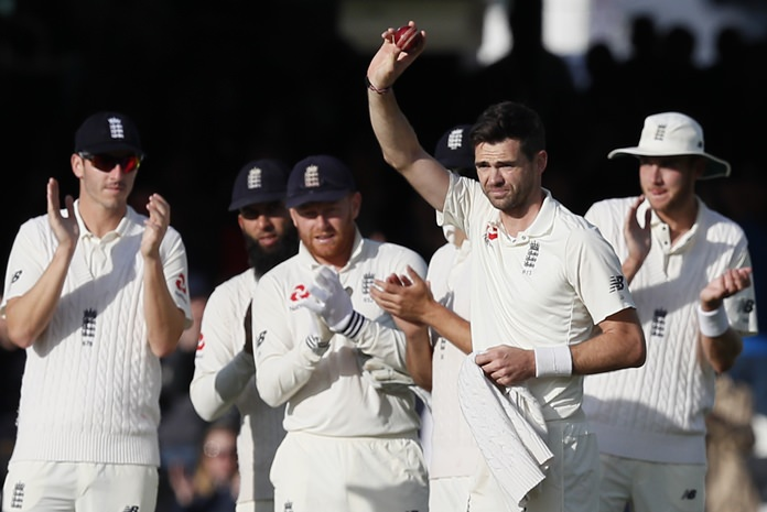 England's James Anderson celebrates taking his 500th test wicket on the second day of the third test match between England and the West Indies at Lord's cricket ground in London, Friday, Sept. 8. (AP Photo/Kirsty Wigglesworth)