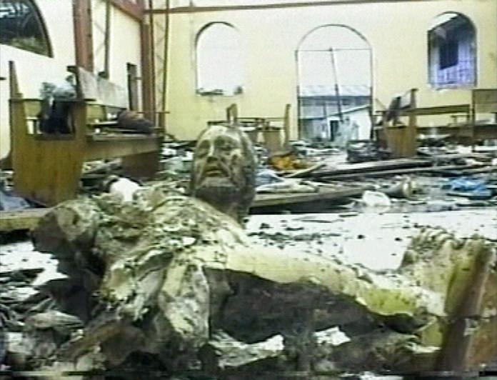 In this file frame grab made from video taken on May 8, 2002, a broken statue of Christ lays on the floor of a church in Bojaya, Colombia.(AP Photo/APTN, File)