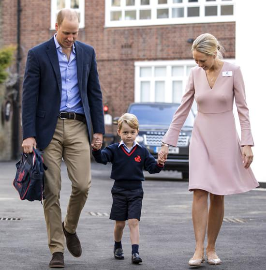 Britain's Prince William, left, accompanies Prince George and Helen Haslem - the head of the lower school on arrival for his first day of school at Thomas's school in Battersea, London, Thursday, Sept. 7, 2017. (Richard Pohle/Pool Photo via AP)
