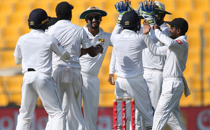 Sri Lanka players celebrate the dismissal of Pakistan's Asad Shafiq during the third day of the first test in Abu Dhabi, United Arab Emirates, Saturday, Sept. 30. (AP Photo/Kamran Jebreili)