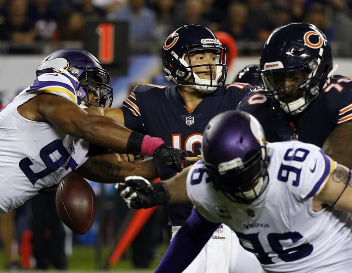 Minnesota Vikings defensive end Everson Griffen, left, strips the ball from Chicago Bears quarterback Mitchell Trubisky, centre, during the first half of an NFL football game, Monday, Oct. 9, in Chicago. (AP Photo/Charles Rex Arbogast)
