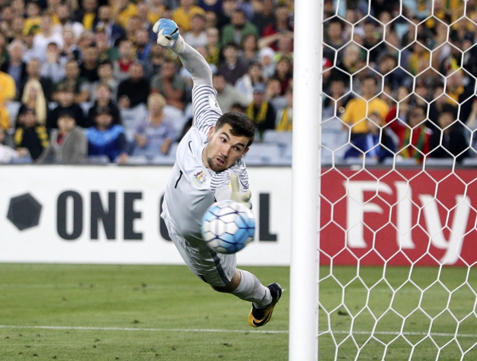 Australia's keeper Mathew Ryan dives at a ball that hit the post from a Syrian free kick during their World Cup qualifying match in Sydney, Australia, Tuesday, Oct. 10. (AP Photo/Rick Rycroft)
