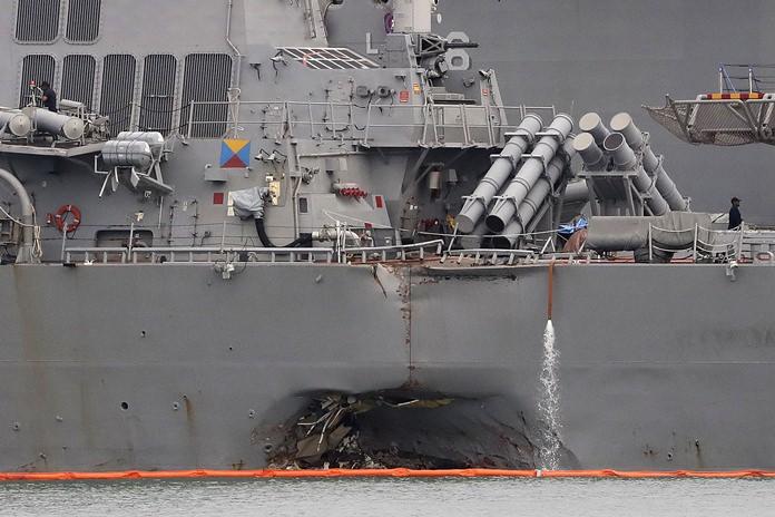 This Aug. 22, 2017 file photo shows the damaged port aft hull of the USS John S. McCain while docked at Singapore's Changi naval base. (AP Photo/Wong Maye-E)