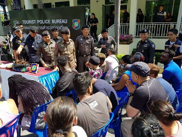 Special Branch and Immigration police raided a dozen spots in Pattaya, arresting 18 foreign fugitives and suspected criminals.