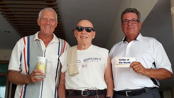 Gordon Clegg (left) and John Pierrel (right) with Bill Jones of BJ's Holiday Lodge.