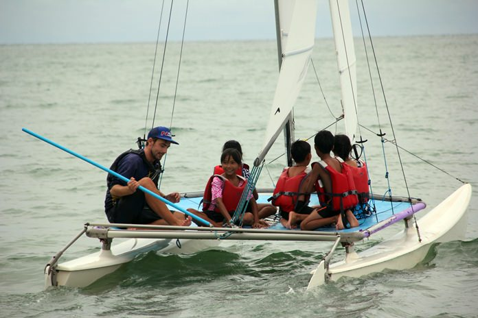 The children are taught how to sail.
