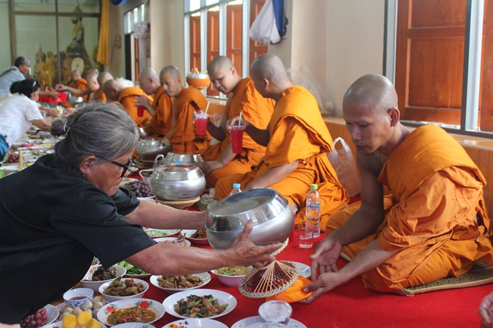 Presenting alms at Wat Suttawas.