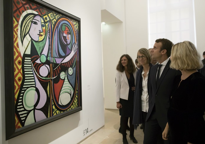 """France's President Emmanuel Macron visits the """"Picasso 1932: Erotic Year"""" exhibition at the Picasso museum in Paris, Sunday, Oct. 8. (Ian Langsdon/pool photo via AP)"""