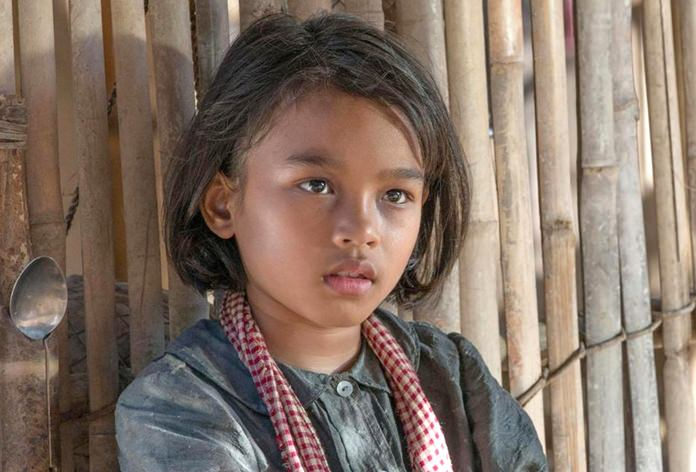 "This image shows Sareum Srey Moch in a scene from ""First They Killed My Father: A Daughter of Cambodia Remembers."" (Roland Neveu/Netflix via AP)"