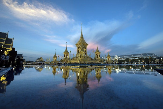 Light fades behind the royal crematorium and funeral complex for the late King Bhumibol Adulyadej in Bangkok on Friday, Oct. 20, 2017. King Bhumibol Adulyadej, who reigned for 70 years before his death on Oct. 13, 2016, is being honored in a royal cremation ceremony from Oct. 25 to 29. (AP Photo/Kittinun Rodsupan)