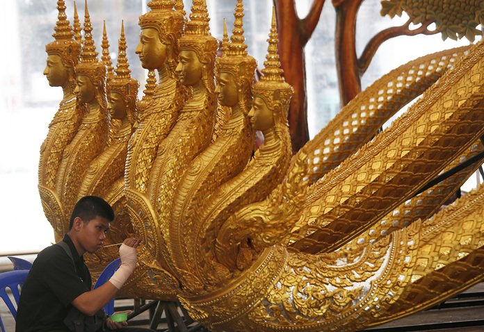 An artist sculpts deities and creatures from ancient epics to decorate the royal crematorium and funeral complex for the late Thai King Bhumibol Adulyadej. (AP Photo/Sakchai Lalit)