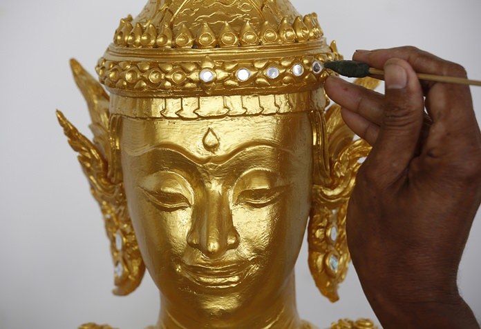 An artist decorates elements of the royal crematorium and funeral complex for the late Thai King Bhumibol Adulyadej. (AP Photo/Sakchai Lalit)