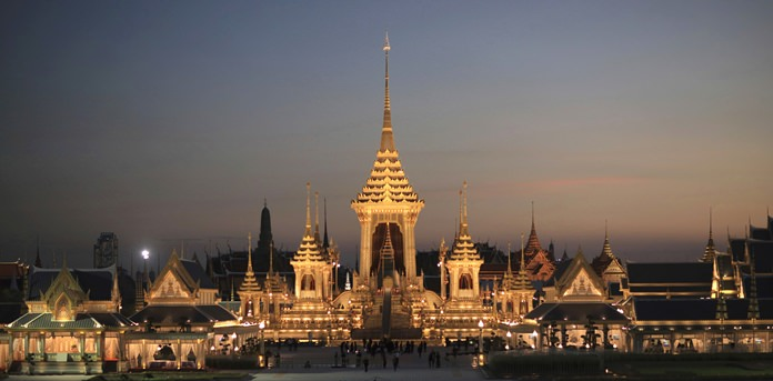 Dusk light fades behind the warmly lit royal crematorium and funeral complex for HM the late King Bhumibol Adulyadej in Bangkok. King Bhumibol Adulyadej, who reigned for 70 years before his death on Oct. 13, 2016, is being honored in an elaborate royal funeral and cremation ceremony from Oct. 25 to 29. In this week's edition, filled with emotion, we say a final goodbye to our most beloved monarch, our hearts filled with sorrow for his departure, but also filled with solemn joy, for deep down inside we know he has taken a place among the greats in heaven. (AP Photo/Wason Wanichakorn)