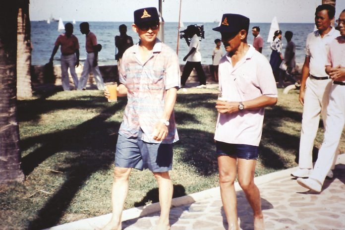 HM the King and HSH Prince Bhisadej head for the dinghies at the Palace beach.