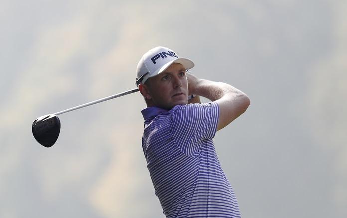 Matt Wallace, of Britain, tees off during the third round of the Italian Open Golf tournament in Monza, Italy, Saturday, Oct. 14. (AP Photo/Antonio Calanni)