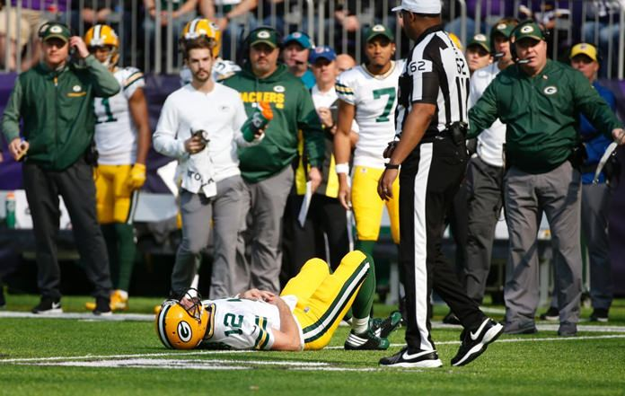 Green Bay Packers quarterback Aaron Rodgers (12) lies on the ground after being hit by Minnesota Vikings outside linebacker Anthony Barr in the first half of an NFL football game in Minneapolis, Sunday, Oct. 15. (AP Photo/Bruce Kluckhohn)