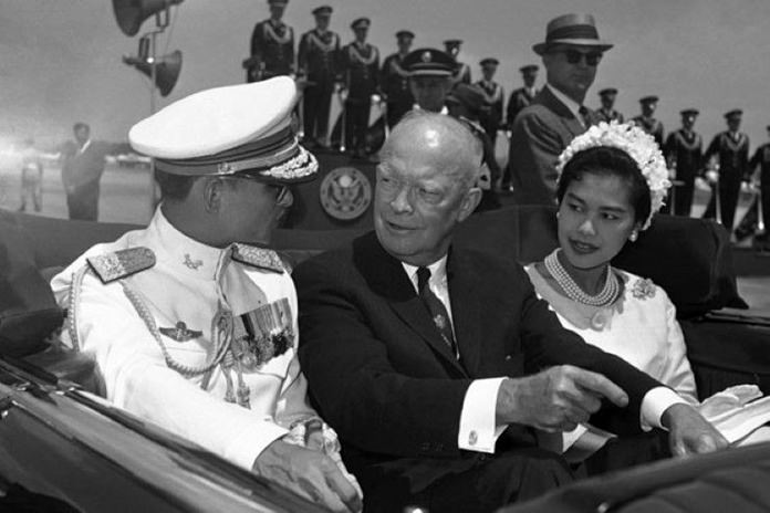 In this June 28, 1960, file photo, U.S. President Dwight Eisenhower, center, is seated between His Majesty King Bhumibol Adulyadej of Thailand, left, and Queen Sirikit for a motorcade drive in Washington D.C. (AP Photo)