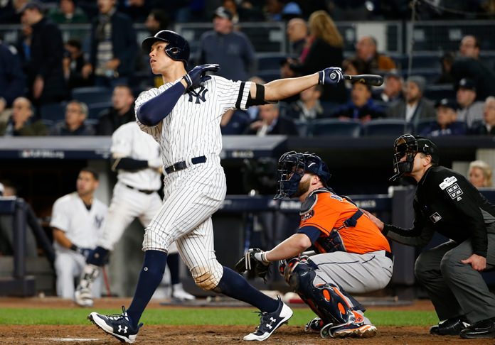 New York Yankees' Aaron Judge hits a home run during the seventh inning of Game 4 of baseball's American League Championship Series against the Houston Astros Tuesday, Oct. 17, in New York. (AP Photo/Kathy Willens)