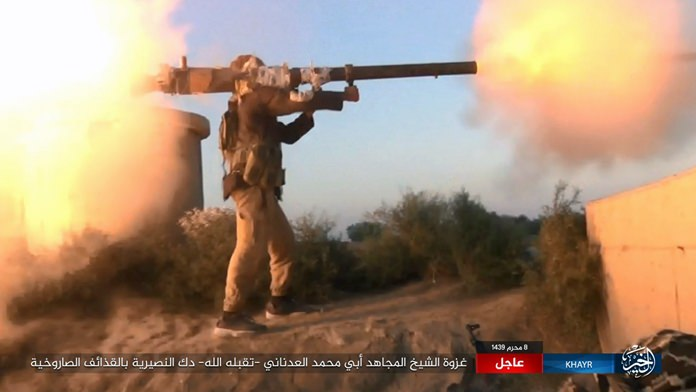 This photo shows an IS fighter firing a weapon during clashes with Syrian government troops in the eastern Syrian province of Deir el-Zour. (Militant Photo via AP)