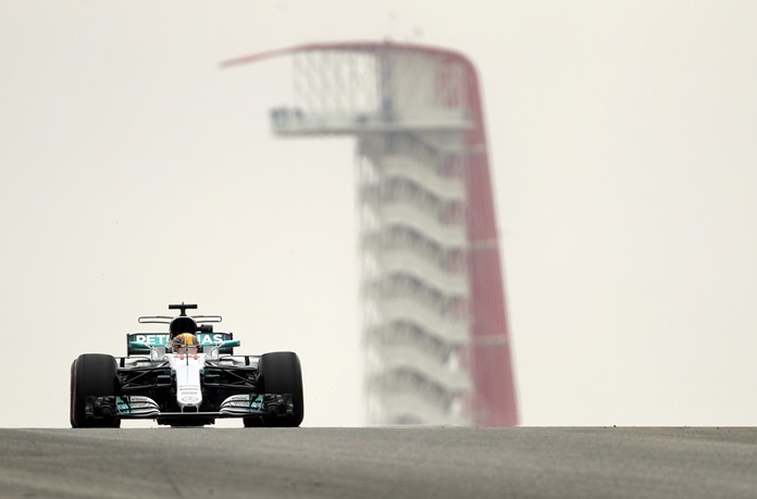 Mercedes driver Lewis Hamilton, of Britain, drives his car during the first practice session for the Formula One U.S. Grand Prix auto race at the Circuit of the Americas, Friday, Oct. 20, in Austin, Texas. (AP Photo/Eric Gay)